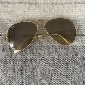 Ray Ban aviators in gold.